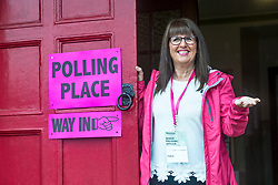 Voters are turning out in lower numbers than the 2015 General Election due to the heavy rain that has been falling on Scotland since the polls opened this morning.<br /> <br /> Pictured: Senior Presiding Office, Linda Cochrane checks the weather at the door of the Polling Place at Wilson Memorial United Free Church of Scotland in Edinburgh