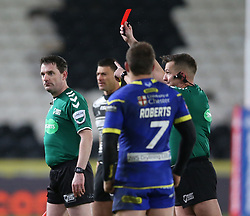Referee Ben Thaler shows Warrington Wolves Declan Patton (out of picture) a red card during the Betfred Super League match at the KCOM Stadium, Hull.