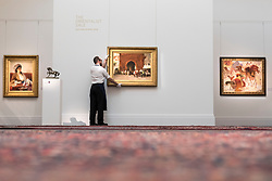 "© Licensed to London News Pictures. 20/04/2018. LONDON, UK. A technician presents (C) ""Rabat (The Red Gate)"" by Edwin Lord Weeks (Est. GBP200-300k), amongst other works at a preview of works in Sotheby's 20th Century Middle East, Orientalist and Islamic upcoming art sales in New Bond Street.  The works will be sold at auction in the last week of April.    Photo credit: Stephen Chung/LNP"