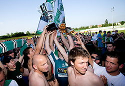 Robert Volk,  David Kasnik and Green Dragons  at award ceremony celebrate with the Cup after final match of 2nd SNL league between NK Olimpija in NK Aluminij, on May 23, 2009, ZAK, Ljubljana, Slovenia. Aluminij won 2:1. NK Olimpija is a Champion of 2nd SNL and thus qualified to 1st Slovenian football league for season 2009/2010. (Photo by Vid Ponikvar / Sportida)
