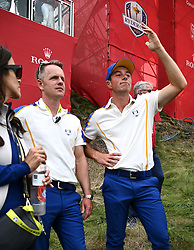 Team Europes' Viktor Hovland (right) reacts as Team USA win the Ryder Cup during day three of the 43rd Ryder Cup at Whistling Straits, Wisconsin. Picture date: Sunday September 26, 2021.
