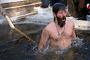 Moscow, Russia, 19/01/2006..Russian priests and Orthodox believers celebrate Epiphany at Serebryany Bor in northern Moscow. Priests blessed the waters and followers baptised themselves by total immersion in the freezing Moscow River in temperatures of minus 30C.