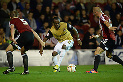 Leyton Orient's Moses Odubajo runs with the ball at Brentford's Tony Craig and Brentford's Alan McCormack   - Photo mandatory by-line: Mitchell Gunn/JMP - Tel: Mobile: 07966 386802 23/09/2013 - SPORT - FOOTBALL -  Griffin Park - London - Brentford v Leyton Orient - Sky Bet League One