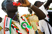 A Convention People's Party (CPP) supporter blows in a whistle during a rally in Accra, Ghana on Sunday September 21, 2008.