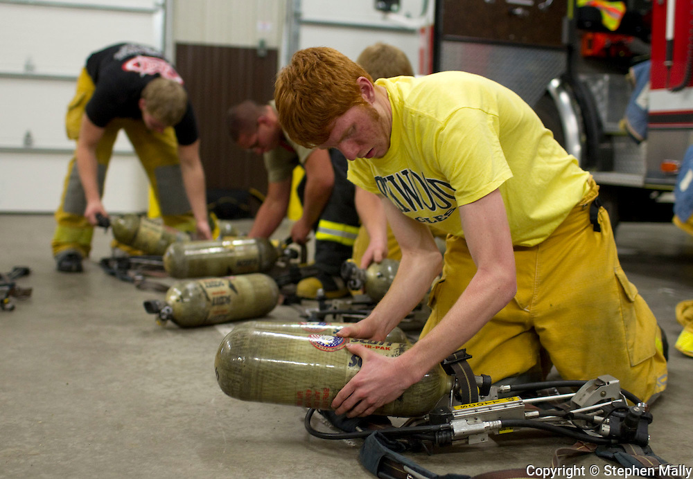 Jason Fangman, 18 years old, Iowa City West senior, of North Liberty, attaches a new air canister to his gear during a job shadow with the Iowa City Fire Department at the Iowa City Fire Department Training Center, 1001 South Clinton Street, in Iowa City on Thursday afternoon, November 18, 2010. The job shadow was organized by Workplace Learning Connection.