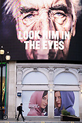 A government NHS National Heath Service advert displays the face of a Covid patient, urging Londoners to stay at home and not to take risks or bend the rules during the third lockdown of the Coronavirus pandemic, at Piccadilly Circus in the capitals West End, on 2nd February 2021, in London, England.