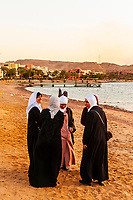 Arab women enjoying the beach at the Radisson Blu Tala Bay Resort on the Gulf of Aqaba, Red Sea, near Aqaba, Jordan