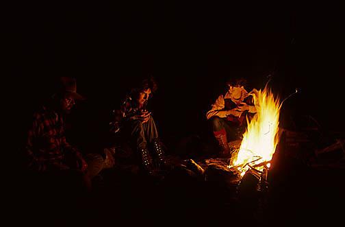 Quetico Provincial Park, Canada. Canoeists enjoying warm campfire on island.
