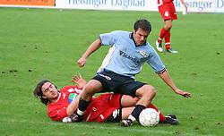 FODBOLD: Patrik Norell (Helsingør) tackles af Polat Bozkurt (B.93) under kampen i Landspokalturneringen, 2. runde, mellem Elite 3000 Helsingør og B.93 den 23. august 2006 på Helsingør Stadion. Foto: Claus Birch
