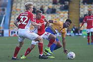 George Lapslie of Charlton Athletic (32) and Jamie Ward of Charlton Athletic (16) challenge Jacob Mellis of Mansfield Town (8) during the The FA Cup match between Mansfield Town and Charlton Athletic at the One Call Stadium, Mansfield, England on 11 November 2018.