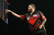 Michael Smith during the PDC World Darts Championship at The MotorPoint Arena, Cardiff. Pictures taken by Shane Healey.