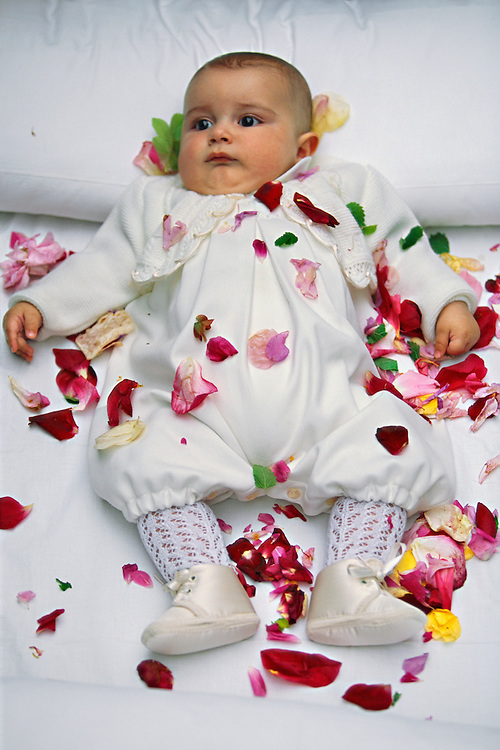 Sprinkled with rose petals, an infant lies on a mattress after being jumped over by El Colacho, the devil incarnate, during the Fiesta del Colacho, in Castrillo de Murcia, Burgos province, Spain. The Fiesta del Colacho is held every year at the time of the Catholic feast Corpus Christi, and the jumping over children born during the year is intended to protect them from illness and misfortune.