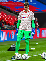 LONDON, ENGLAND - MARCH 31: Wojciech Szczesny of Poland look down during the FIFA World Cup 2022 Qatar qualifying match between England and Poland on March 31, 2021 in London, United Kingdom. Sporting stadiums around the UK remain under strict restrictions due to the Coronavirus Pandemic as Government social distancing laws prohibit fans inside venues resulting in games being played behind closed doors. (Photo by Wlosek/PressFocus/MB Media)