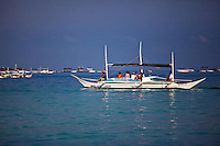 Boats on the bay at White Sand Beach, Boracay, Philippines.