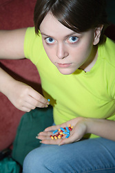 Young woman taking pills,