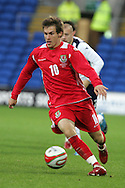 Aaron Ramsey of Wales. Wales v Scotland, friendly international football match at the Cardiff City stadium, Cardiff, Wales, UK on Sat 14th Nov 2009.  pic by Andrew Orchard, Andrew Orchard sports photography