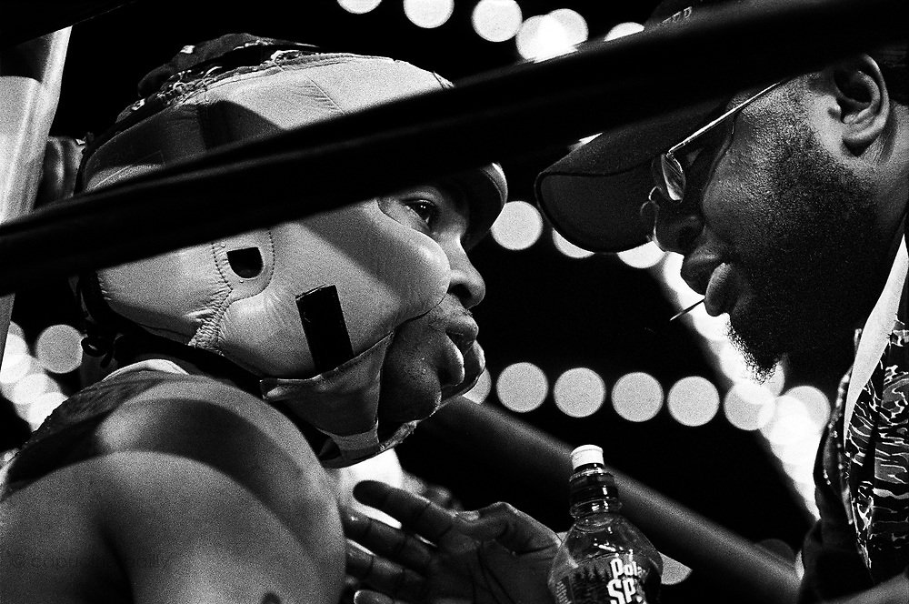 Wezley Hobbs, 20, from Gleason's Gym, is being coached by his trainer during the 2005 Daily News Golden Gloves 165-pound novice final at the Theatre of Madison Square Garden on April 8th.