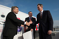 20 MAR 2012, BERLIN/GERMANY:<br /> Willie Walsh, CEO International Airlines Group, IAG, Thomas W. Horton, AMR Corporation und American Airlines Chairman und Chief Executive Officer, (v.L.n.R.), Enthuellung eines ineworld-Logos an einem Air Berlin Flugzeug, anlaesslich der Beitrittserklaerung von Air Berlin zum weltweiten Luftfahrtbuendnis oneworld, Flughafen Berlin Brandenburg<br /> IMAGE: 20120320-01-217