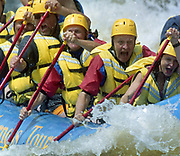 Canadian Prime Minister Jean Chretien (C) paddles his way through the white-water rapids while rafting on the Ottawa River in Foresters Falls, Ontario, July 27, 2000. The 66-year-old prime minister used the event to show off his vigor in the face of a challenge from a political rival 17 years younger than himself.  Reuters/Jim Young
