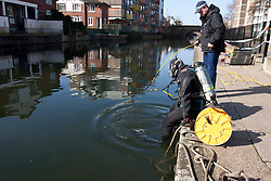 © licensed to London News Pictures. London, UK 08/03/2012. A police marine unit prepares to dive in Regents Canal in east London where a torso, thought to be that of TV actress Gemma McCluskie's  was found yesterday. Photo credit: Tolga Akmen/LNP