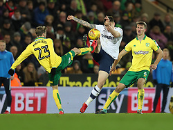 Norwich City's James Maddison challenges Preston North End's Jordon Hugill as Norwich City's Christoph Zimmermann looks on during the Sky Bet Championship match at Carrow Road Norwich.