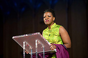 The daughter of former archbishop Desmond Tutu, Reverend Mpho Tutu speaks at a ceremony where her father is receiving the 2013 Templeton Prize at the Guildhall in London, UK. South African anti-apartheid campaigner Desmond Tutu won the 2013 Templeton Prize worth $1.7 million for helping inspire people around the world by promoting forgiveness and justice.