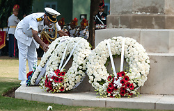 © Licensed to London News Pictures. 11/11/2012. Delhi, India. An officer of the Indian Navy places a wreath at a memorial at a Remembrance Day ceremony held at the Delhi War Cemetery, India. Remembrance Day (also known as Poppy Day or Armistice Day) is a memorial day observed in Commonwealth countries since the end of World War I to remember the members of their armed forces who have died in the line of duty. This day, or alternative dates, are also recognized as special days for war remembrances in many non-Commonwealth countries. Remembrance Day is observed on 11 November to recall the end of hostilities of World War I on that date in 1918.   Photo credit : Richard Isaac/LNP