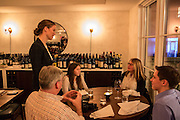 New York, NY, - December 8, 2013. Barbara Lambert talking to diners in the Barrel Room. Lambert and her husband Matt Lambert are co-owners of The Musket Room, 265 Elizabeth St.