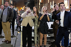 © Licensed to London News Pictures . 04/01/2019 . Manchester , UK . People watch as firefighters attend a fire at the Ivy Restaurant and bar lounge in Spinningfields in Manchester . Photo credit : Joel Goodman/LNP
