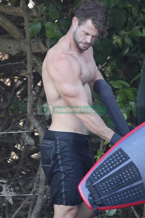 AU_1904362 - *PREMIUM-EXCLUSIVE* Byron Bay, AUSTRALIA  -  <br /> Chris Hemsworth shows off his surfing skills and ripped muscles while out surfing in Byron Bay.<br /> <br /> Pictured: Chris Hemsworth<br /> <br /> BACKGRID Australia 22 MARCH 2020 <br /> <br /> BYLINE MUST READ: KHAPGG / BACKGRID<br /> <br /> Phone: + 61 419 847 429<br /> Email:  sarah@backgrid.com.au