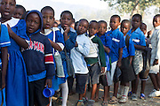 Mcc0039986 . Daily Telegraph..DT Weekend..Telegraph sponsored Chirimba Primary School in Blantyre,Malawi where the Charity Mary's Meals feeds 6000 children from the ages of 6-16 every school day..Mary's meals feeds over 500,000 children in Malawi over 600,000 children worldwide. Malawi is one of the poorest countries in the world and the concept behind Mary's Meals is to provide a daily meal in a place of education, attracting chronically poor children to the classroom where they can gain a basic education that could one day provide an escape route out of poverty. ..Malawi 20 May 2012.