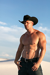 muscular cowboy outdoors
