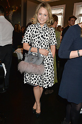 POPPY JAMIE at the mothers2mothers Mother's Day Tea hosted by Nadya Abela at Morton's, Berkeley Square, London on 12th March 2015.  mothers2mothers is a charity working to eliminate mother to child transmission of HIV/AIDS across sub-Saharan Africa.