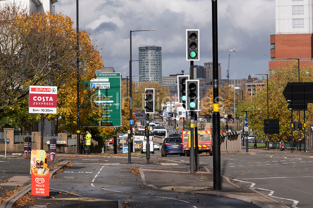 Traffic lights along the A38 Bristol Road looking towards the iconic Rotunda building on 26th October 2020 in Birmingham, United Kingdom. Bristol Road is one of the main roads cutting diagonally through the centre of Birmingham.