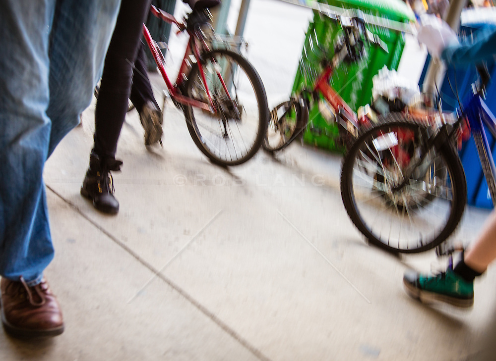 feet and bicycles on the street in New York City