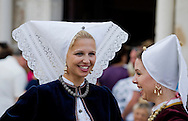 Young Croatian women in traditional local folk costume, during a procession on Assumption Day (Velika Gospa), Pag, Croatia, 15 August. © Rudolf Abraham