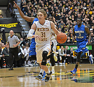 WICHITA, KS - JANUARY 18:  Guard Ron Baker #31 of the Wichita State Shockers brings the ball up court against the Indiana State Sycamores during the first half on January 18, 2014 at Charles Koch Arena in Wichita, Kansas.  (Photo by Peter G. Aiken/Getty Images) *** Local Caption *** Ron Baker