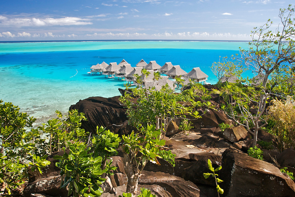 View over the Bora Bora lagoon, with bungalows belonging to the Bora Bora Nui Resort & Spa. Previously a Starwood Luxury Collection property, the Bora Bora Nui is now operated by Hilton. Bora Bora is one of the Leeward Islands in the Society Islands archipelago of French Polynesia.