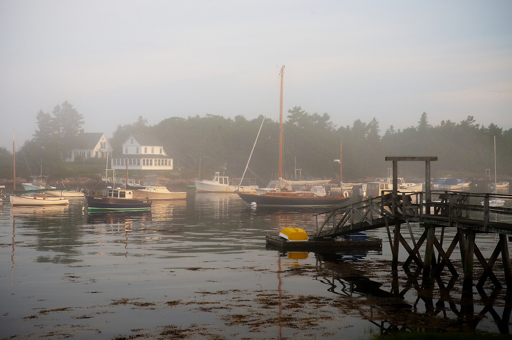 Sunrise finds a mixture of fishing and pleasure boats in the morning mist.