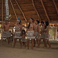 Amazon Indians of the Bora tribe near Iquitos, Peru dance for tourists - often a sideline to more modern workaday jobs.