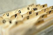 close up of alphabetized filing folders