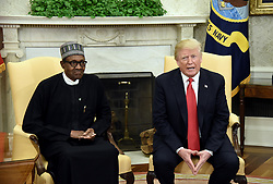 US President Donald Trump meets with Nigerian President Muhammadu Buhari in the Oval Office of the White House on April 30, 2018 in Washington, DC. Photo by Olivier Douliery/Abaca Press