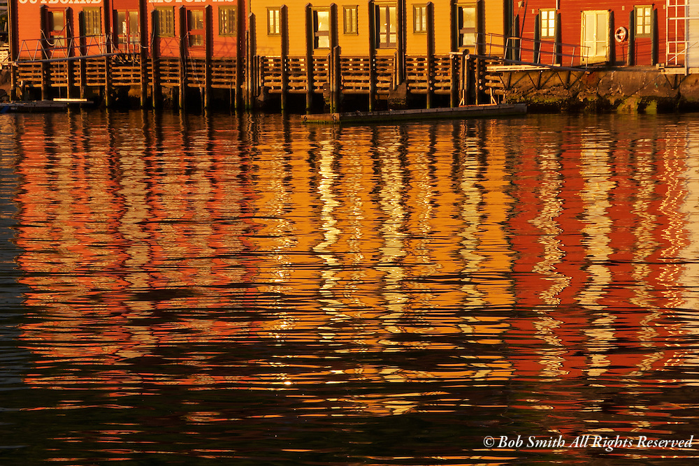 Reflections at sunset in the harbor at Bergen, Norway.