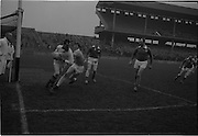 21/02/1965<br /> 02/21/1965<br /> 21 February 1965<br /> Munster v Ulster Railway Cup semi-final at Croke Park. The final score was Ulster 0-14 Munster 0-9.<br /> Munster goalie J. Culloty clears his line under pressure from Ulster's J. Carroll.