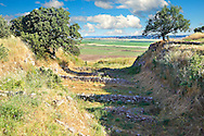 Part of the Schliemann Trench excavated from 1871 with remains of the original walls and Bronze age house walls of Troy from the Early Troia I Period, c. 2920 B.C. Troy archaeological site, A UNESCO World Heritage Site, Turkey .<br /> <br /> If you prefer to buy from our ALAMY PHOTO LIBRARY  Collection visit : https://www.alamy.com/portfolio/paul-williams-funkystock/troy-archaeological-site-turkey.html<br /> <br /> Visit our ANCIENT WORLD PHOTO COLLECTIONS for more photos to download or buy as wall art prints https://funkystock.photoshelter.com/gallery-collection/Ancient-World-Art-Antiquities-Historic-Sites-Pictures-Images-of/C00006u26yqSkDOM