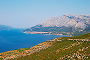 View over the Orebic village town and the Sveti Ilija mountain, dark blue sea towards Korculanski Kanal and the Korcula island. Peljesac Peninsula. Orebic town. Peljesac peninsula. Dalmatian Coast, Croatia, Europe.