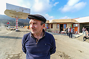 People started working and renovating a petrol station (not in picture) on the road from Goris to Stepanakert throughout the Lachin Corridor, in the self-proclaimed Nagorno-Karabakh Republic on Tuesday, Dec 22, 2020. Kamo Avetyan (in picture) started renovating his petrol station facilities at the entry of Stepanakert, while trucks of Azerbaijan army (not seen in this picture), accompanied by Russian peacekeeping troops drove along the Lachin corridor. Saddened seeing Azerbaijani army troops driving beside his business site, he said the war is not over. Russian peacekeepers control the five-kilometre-wide Lachin corridor, which provides communication between Nagorno-Karabakh and Armenia, the safe return of people to their places of residence, and the movement of civilian vehicles. The corridor is a mountain pass connecting Armenia and the enclave of Nagorno-Karabakh. The corridor is de jure in the Lachin District of Azerbaijan, but de facto in the Kashatagh Province of the self-proclaimed Republic of Artsakh. It contains the town of Lachin and the villages of Zabux and Sus. (Photo/ Vudi Xhymshiti)