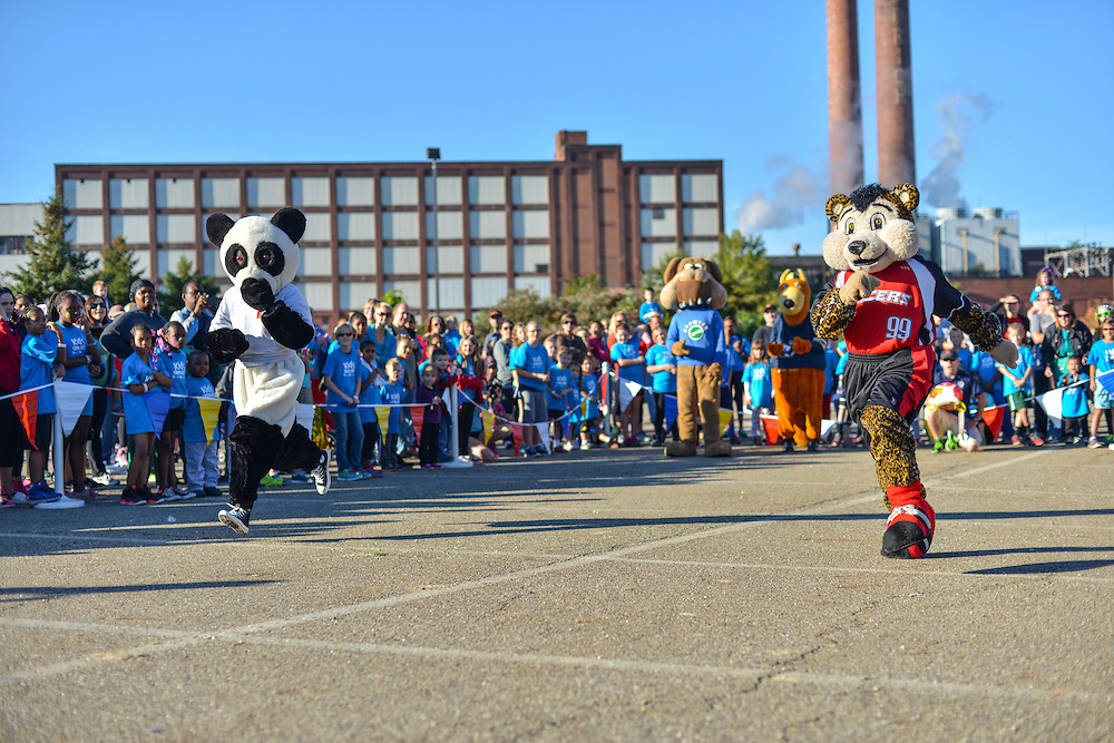 Akron mascots entertaining at the Kids Fun Run.