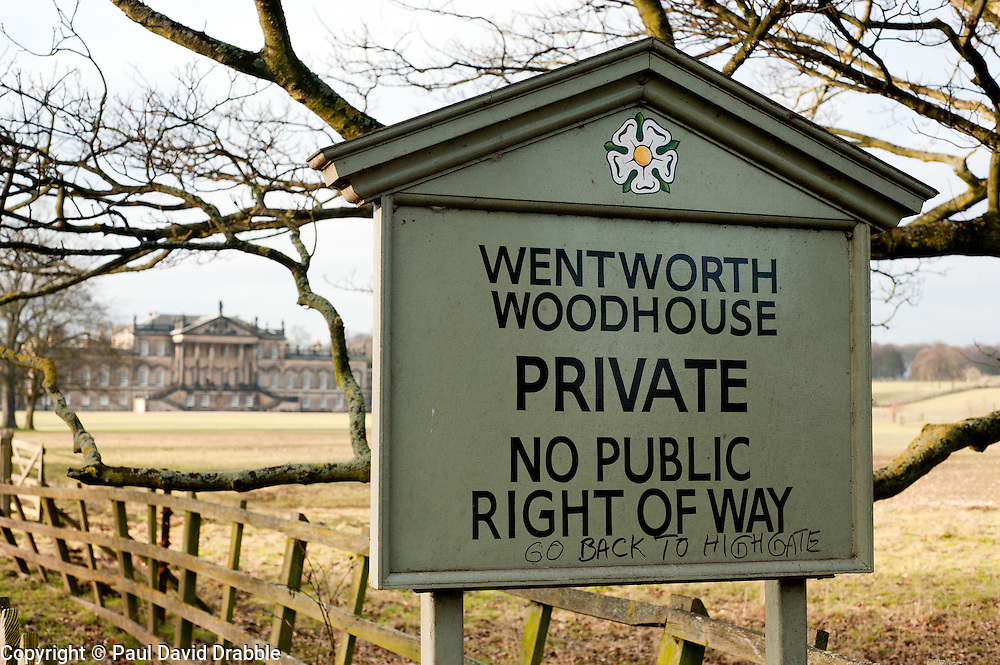 Sign bearing graffiti aimed at retired architect Clifford James Newbold from Highgate and the current owner  of  Wentworth Woodhouse, a Grade I listed country house near the village of Wentworth in South Yorkshire. The East Front is  606 ft (185 m) long and is the longest country house façade in Europe..The house includes 365 rooms and covers an area of over 2.5 acres (10,000 Sq meters)..29 January 2010.Images © Paul David Drabble
