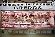 Meat and sausage shop called Los Gredos in the municipal market in Salamanca, Spain.